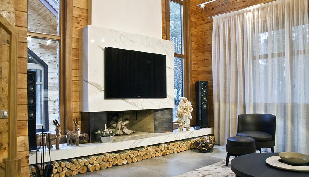 Камины в интерьере гостиной фото из мрамора