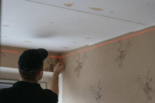 Разметка потолка под каркас для многойровневого потолка