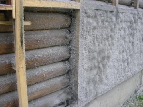 Утепление стен бревенчатого дома эковатой