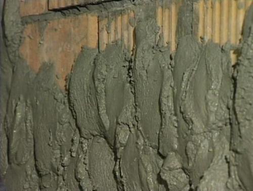 Оштукатуривание стен по маякам